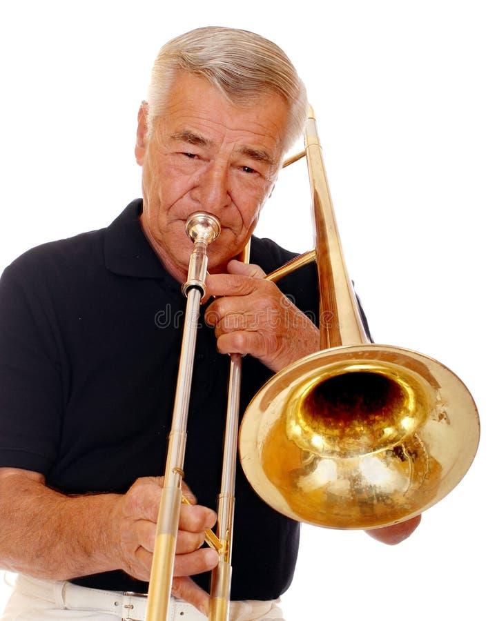 trombone старшия игрока стоковые изображения rf