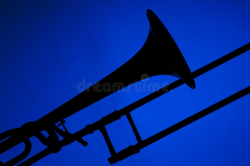 Trombone Silhouette Isolated On Blue Stock Photo - Image ...