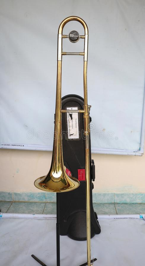 Trombone is a universal brass instrument type. There are bows used for changing the volume. Most will be used in the marching band royalty free stock photo