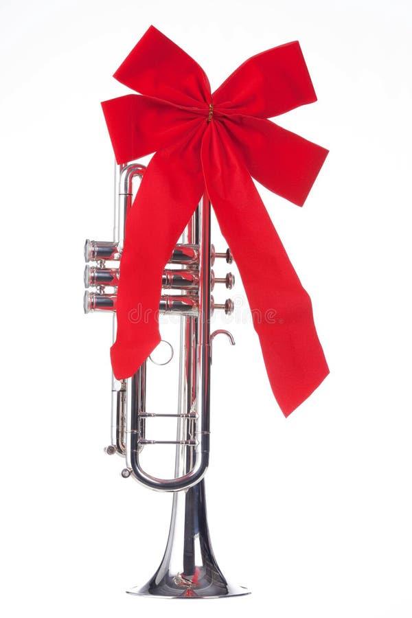 Trompeta de la Navidad con el arqueamiento aislado foto de archivo