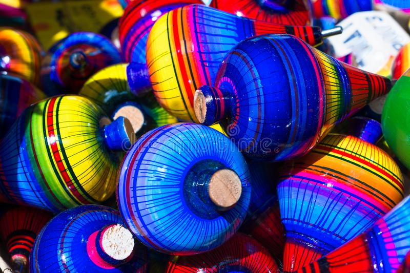There are many tops with many colors. Trompos of colors in a popular market of the magical town of Tonalá Jalisco Mexico stock photos