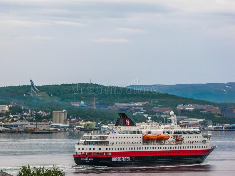Hurtigruten in Tromso, Norway. TROMSO, NORWAY - JULY 5, 2010: The Hurtigruten, a Norwegian cruise, ferry and cargo operator traveling from the south to the north royalty free stock photos