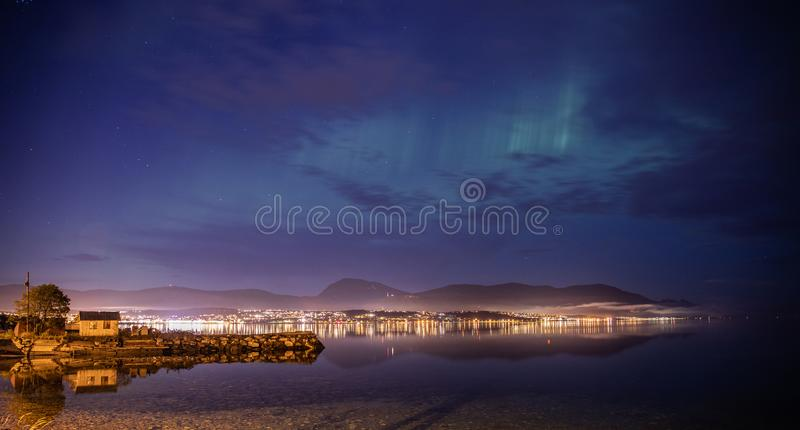 Tromso in Norway at night time. Love, auroraborealis, northernlights, norwegian, sky, green, clouds, water, shadow, shade, amazing, print, officeprints royalty free stock photos