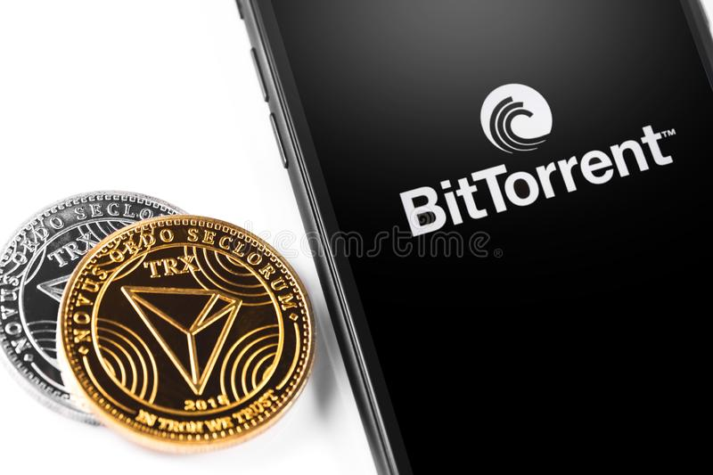 Tron TRX logo. Tron TRX coins and smartphone with BitTorrentLIVE logo. Website of BitTorrent, a communication protocol for peer-to-peer file sharing P2P. Moscow royalty free stock photography