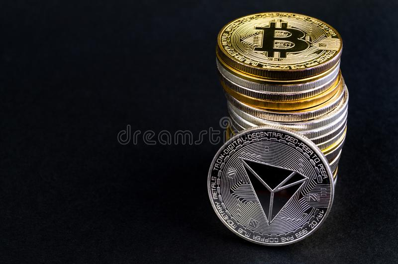 Tron TRX es una manera moderna de intercambio y esta moneda crypto es los medios del pago convenientes en el mercado financiero y imagenes de archivo