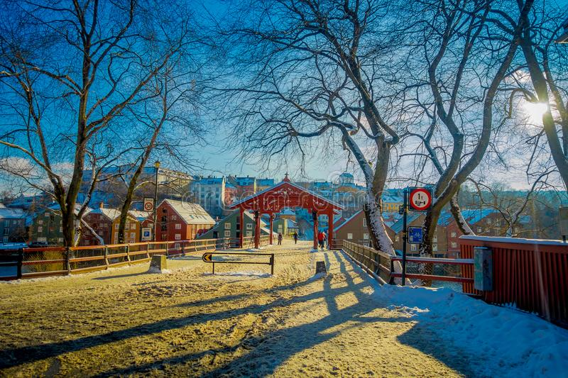 TRONDHEIM, NORWAY - APRIL 04, 2018: Outdoor view of people walking close to old town bridge or Gamle Bybro or Bybroa is stock photos