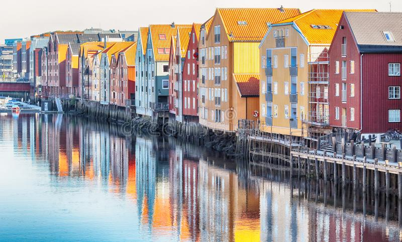 Trondheim. Timber historical buildings located along the river Nidelva in the norwegian city Trondheim stock photos