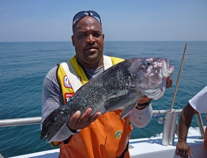Trophäe-Fisch-Fang auf dem Morgen-Stern lizenzfreie stockfotografie
