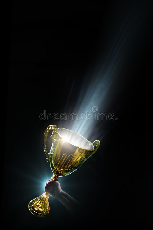 Trophy. Hand holding the victory cup. Power energy. Background. Isolated royalty free stock photos