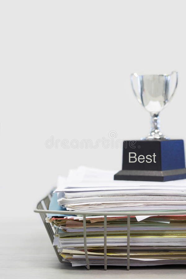 Trophy on Top of Papers saying best stock images