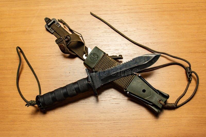 Tropiący nóż lub łowiący obrazy stock