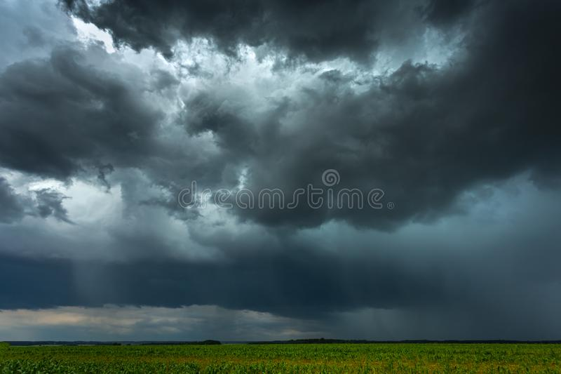 Tropic storm clouds with micro burst rain. Picture of Storm clouds with micro burst in Lithuania royalty free stock photos
