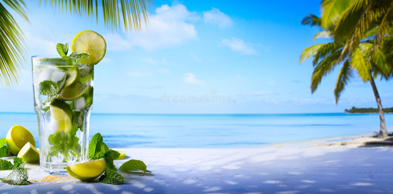 tropic summer vacation; Exotic drinks on blur tropical beach background royalty free stock image