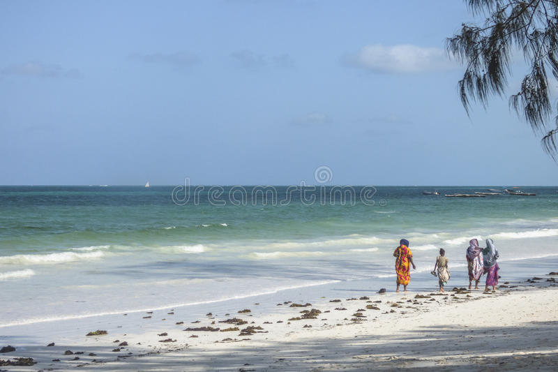 Tropical African Beach. Place on tropical beach in Kiwengwa Village next to the Kiwenga Beach resort on Zanzibar Island. Tanzania , Africa. Muslim woman on the stock images