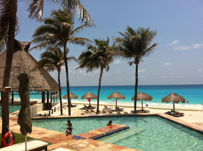 A Tropical Afternoon by the Pool in Cancun, Mexico royalty free stock photos