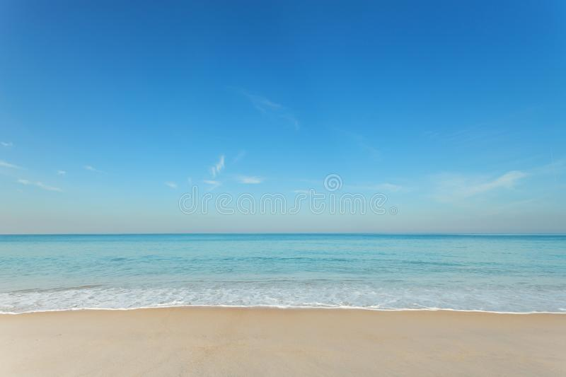 Tropical andaman seascape scenic off mai khao beach and wave crashing on sandy shore in phuket thailand,can be used for air trans. Port to travel and open season royalty free stock photography
