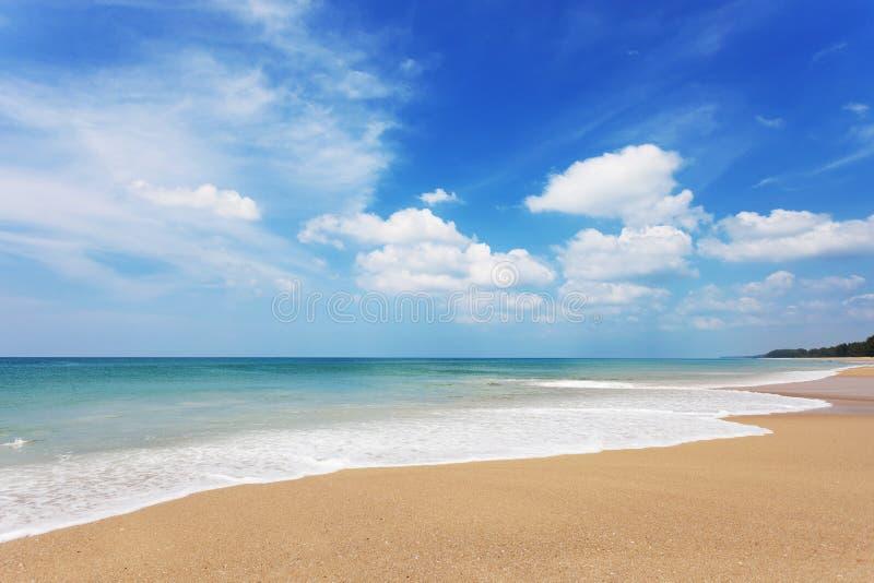 Tropical andaman seascape scenic off sandy beach phuket thailand. With wave crashing on sandy shore royalty free stock photos