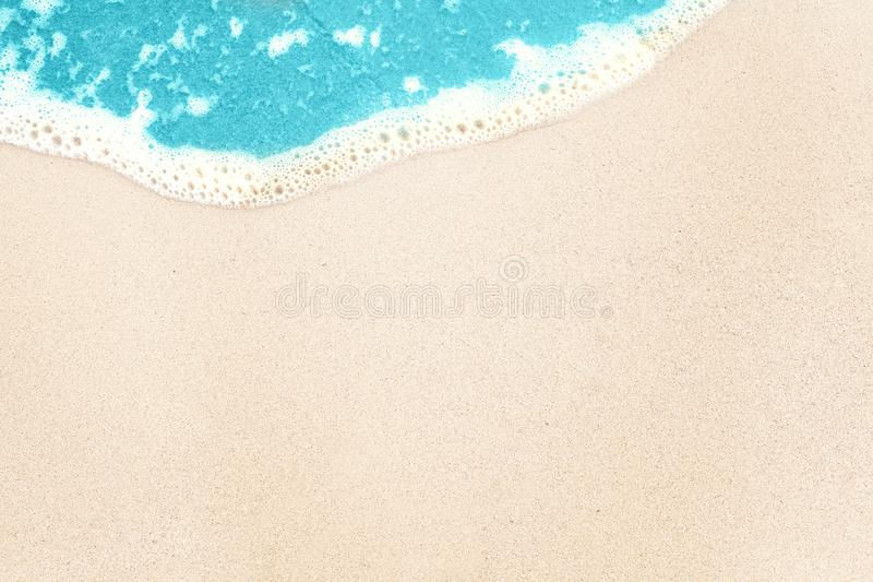 Tropical background with white sea beach sand and blue surf texture background stock photos