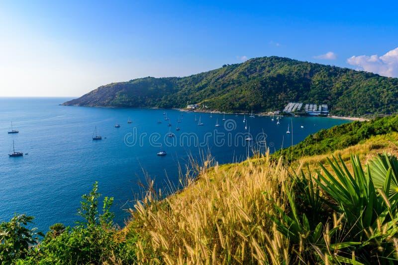 Tropical bay at Naiharn and Ao Sane beach with boats at windmill viewpoint, Paradise destination Phuket, Thailand royalty free stock image