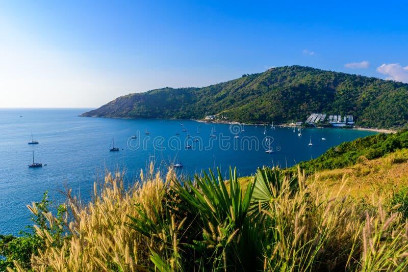 Tropical bay at Naiharn and Ao Sane beach with boats at windmill viewpoint, Paradise destination Phuket, Thailand stock images