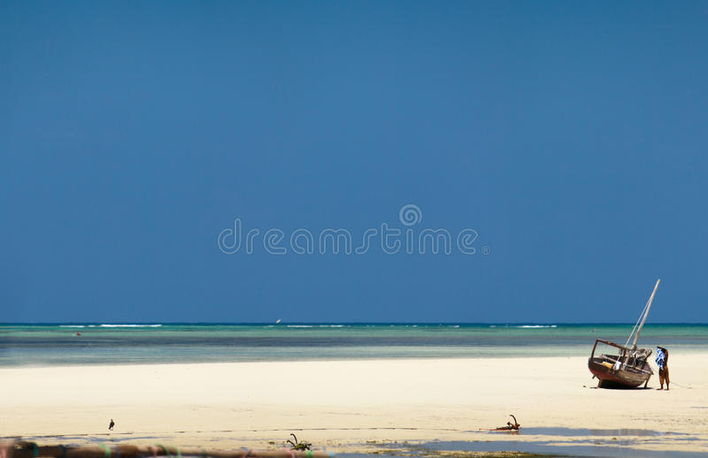Tropical beach. Panoramic photo of white sand tropical beach and traditional Zanzibar boats royalty free stock photos
