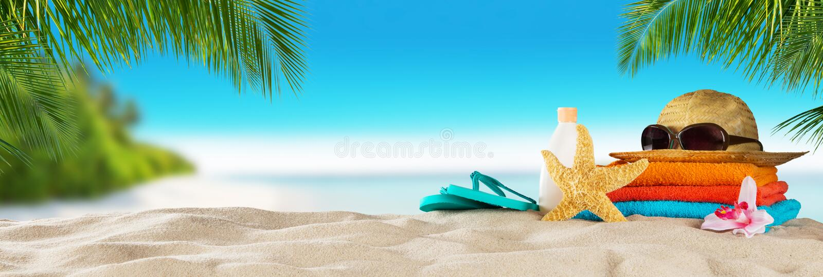 Tropical beach with accessories on sand, summer holiday background. stock photography