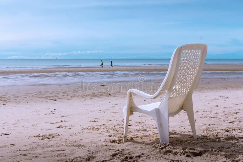 Tropical beach background with beach chair on sand with beautiful blue sea and cloudy sky,Image for summer fun party travel. Concept stock photography