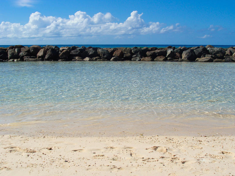 Tropical Beach in Barbados. Tropical Beach with rock and white sand in Barbados royalty free stock images