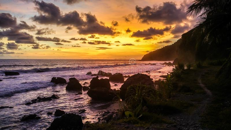 Tropical beach at beautiful sunset - Nature background. Menganti Beach, Kebumen,Central Java, Indonesia stock photography