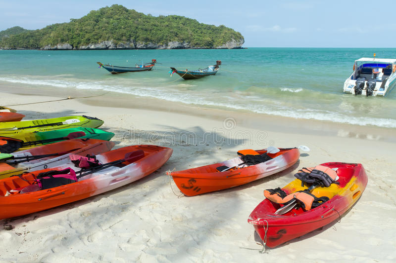 Tropical beach and canoe stock image
