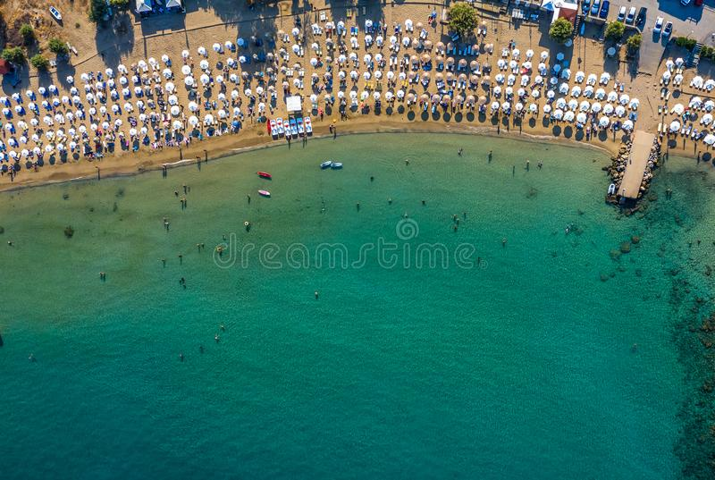 Tropical beach with colorful umbrellas - Top down aerial view. Lindos , Rhodes, Greece stock images