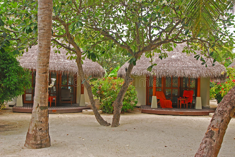 Download Tropical Beach Cottage With Plenty Of Trees On White Fine Sand Stock Image