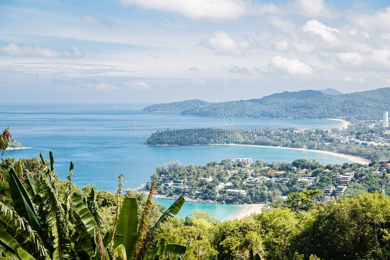 Tropical beach landscape panorama. Beautiful ocean waives with sandy coastline from high view point. Kata and Karon royalty free stock photography