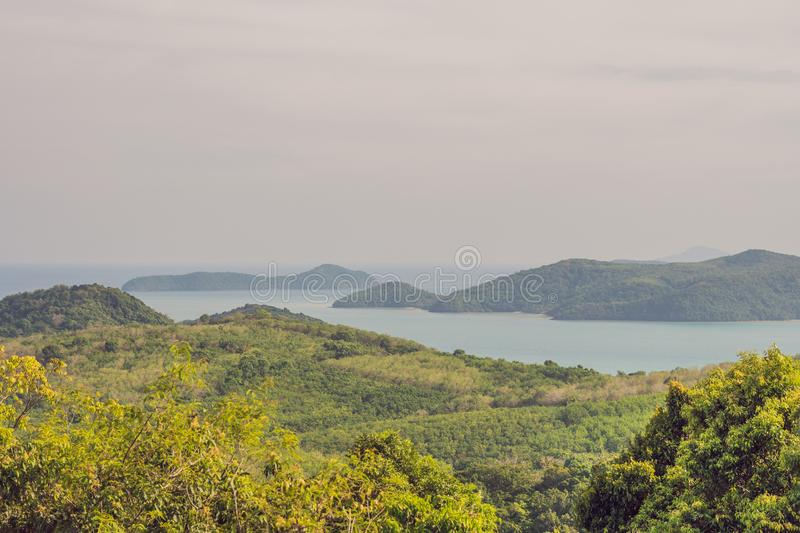 Tropical beach landscape panorama. Beautiful turquoise ocean waives with boats and sandy coastline from high view point. Kata and stock photo