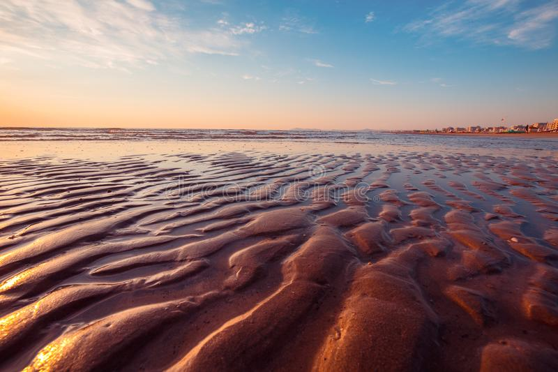Tropical beach at low tide stock images