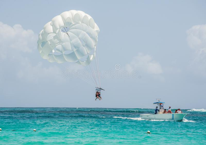 Tropical Beach parasailing with white sands and blue water royalty free stock images