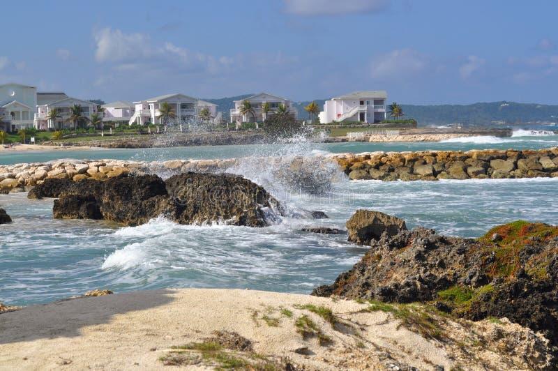 Tropical beach with rough surf stock photos