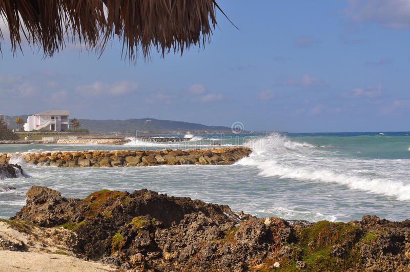 Tropical beach with rough surf stock image