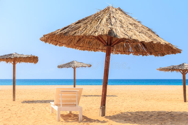 Tropical beach scenery with parasol and deck chairs in Boavista, Cape Verde. Cabo Verde stock photography