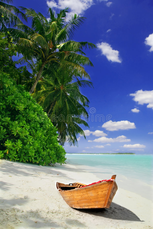 Tropical beach and ship stock photography