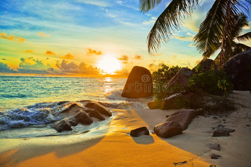 Tropical beach at sunset royalty free stock photos