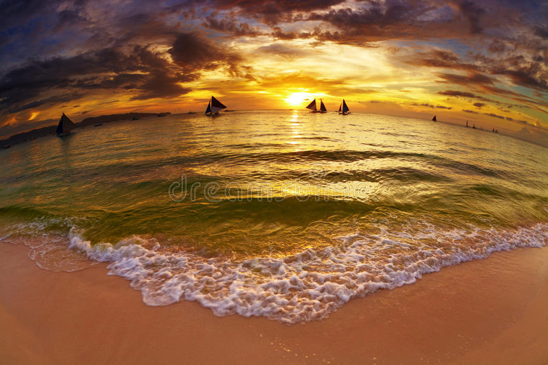 Tropical beach at sunset stock photo
