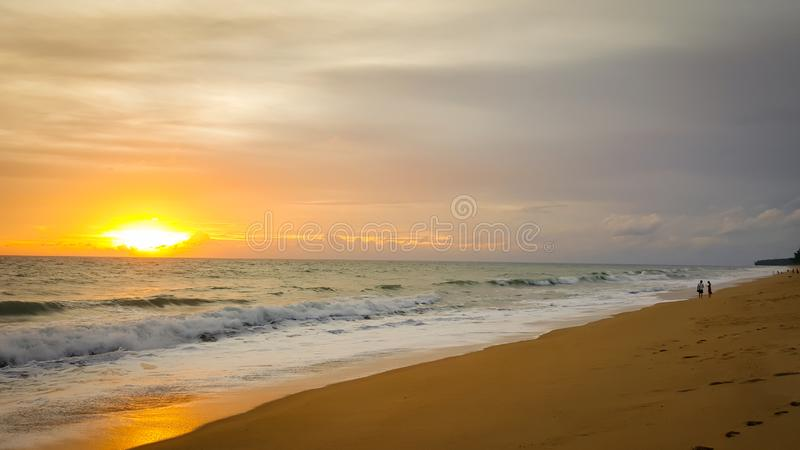Tropical beach sunset with wave in the sea at Maichao beach in Phuket city, Thailand stock photo