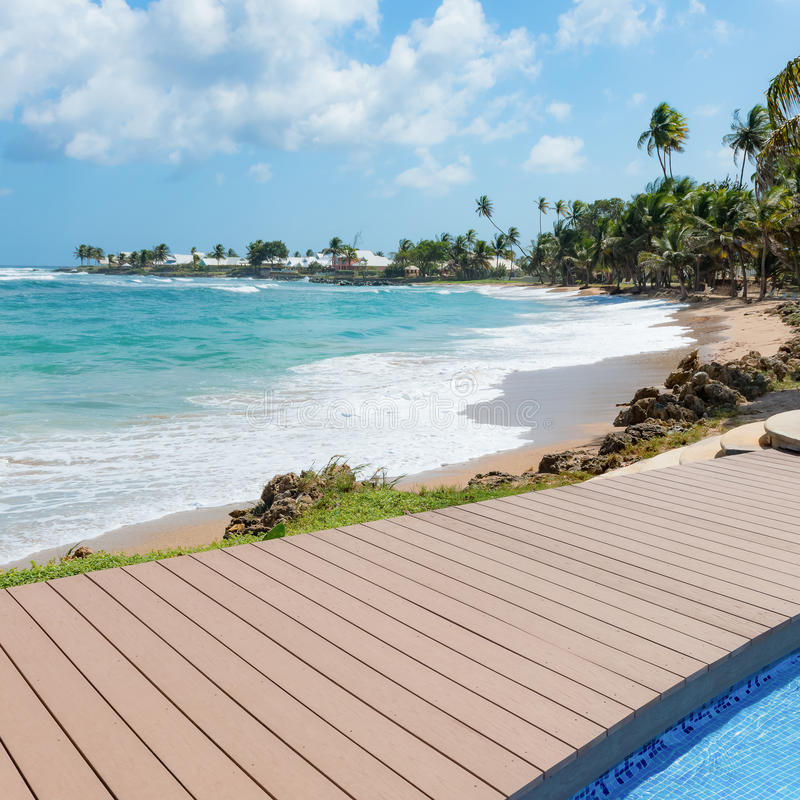 Tropical beach Tobago Caribbean nearby pool and wooden deck square.  stock photography
