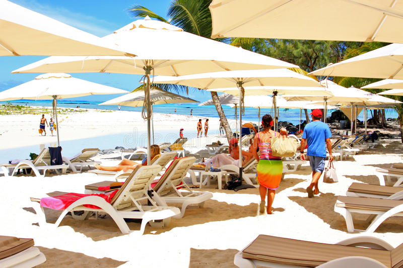 Tropical beach and tourists. In Blue Bay, Mauritius stock images