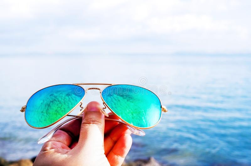 Summer beach trip with blue sunglasses stock photos