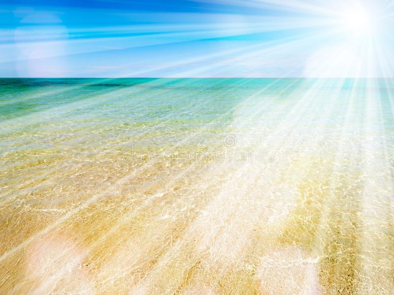 Tropical beach with white sand and turquoise sea and sun royalty free stock images