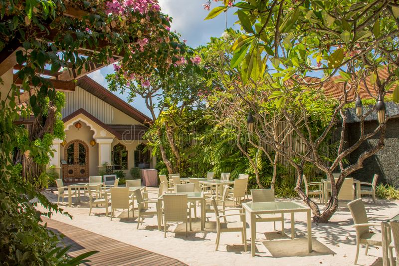 Tropical beautiful outdoor restaurant with table and chairs stock photo
