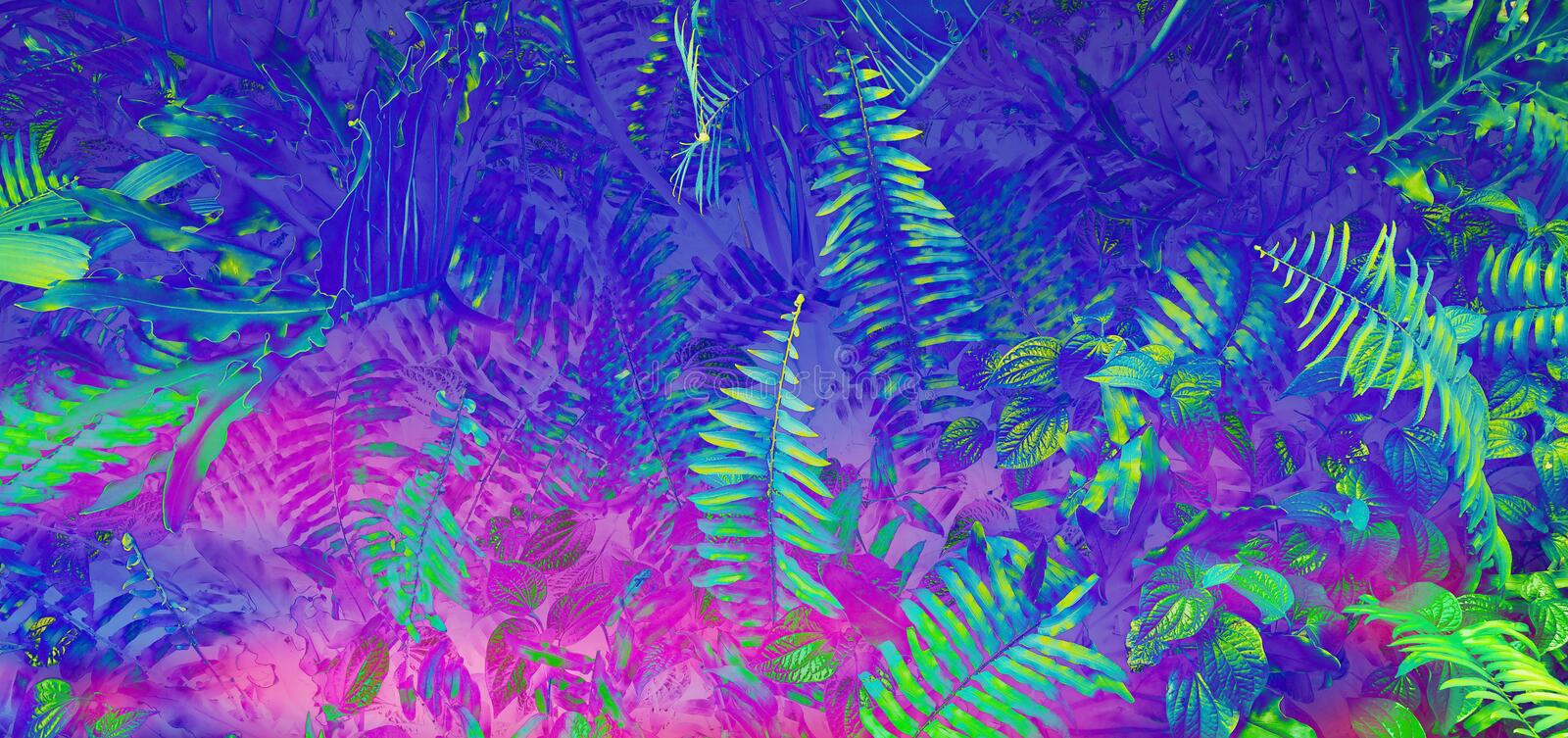 Tropical black light glowing leaves. Tropical leaf forest glow in the black light background. High contrast stock photo