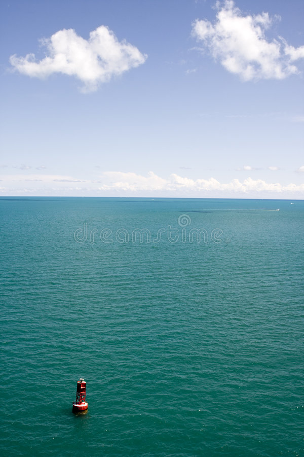 Tropical Blue Water with Buoy stock photo